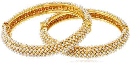 Sia Art Jewellery Pair of Bangles for Women (Golden and White) (AZ264) SIA, http://www.amazon.in/dp/B00HLG2SBA/ref=cm_sw_r_pi_dp_euExtb1623FPN
