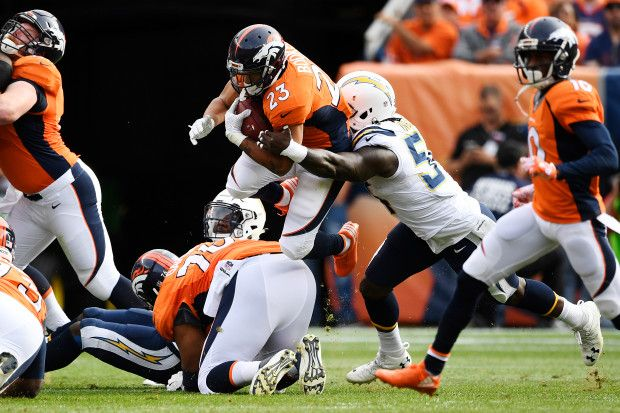 Chargers vs. Broncos:  October 30, 2016  -  27-19, Broncos  -       Devontae Booker (23) of the Denver Broncos is tackled by Melvin Ingram (54) of the San Diego Chargers during the second quarter on Sunday, October 30, 2016. The Denver Broncos hosted the San Diego Chargers.