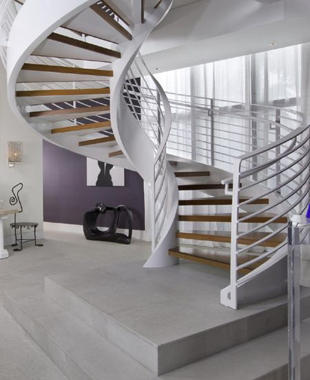 modern contemporary curved staircase with steel sides and timber wood stair treads