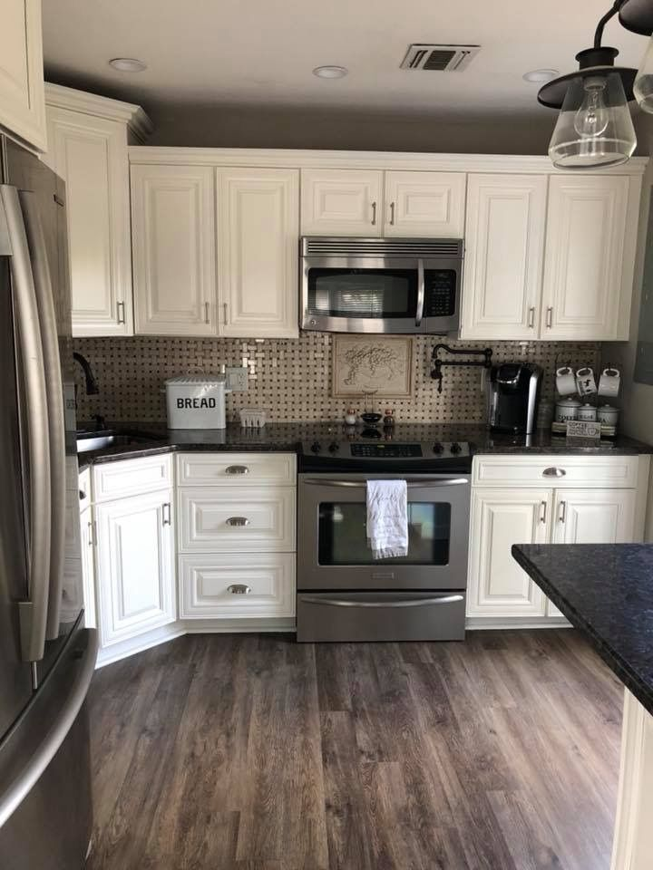 White Kitchen With Silver Appliances