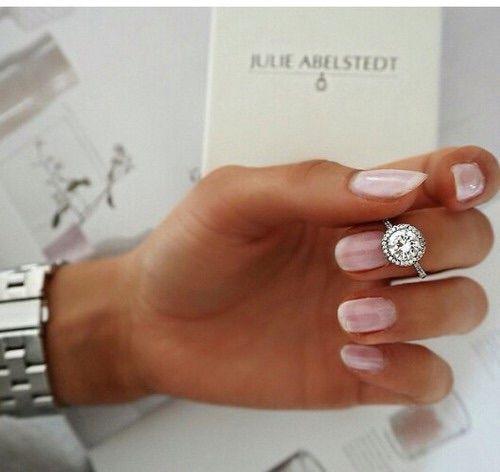 Seriously. Single halo cushion cut diamond ring.