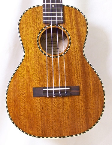 This tenor ukulele has a rich, mellow tone and features a solid mahogany top, back & sides, gloss finish, genuine bone nut & saddle, rosewood fretboard & bridge and sealed gear tuners.
