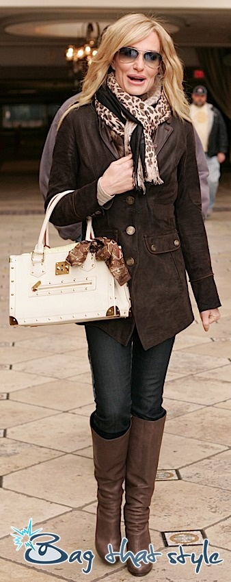 Taylor Armstrong carries Louis Vuitton