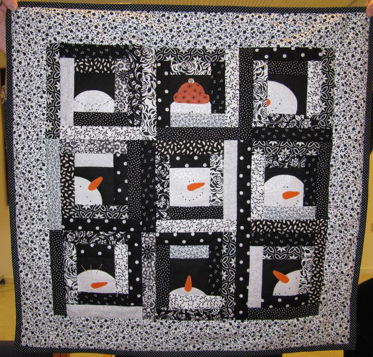 How great is this.  I would have never thought of a black and white snowman quilt, but I love it.
