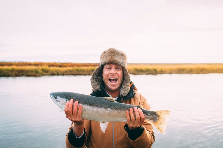 Catch of the day! Wild Ark Ambassador, Mick Fanning reveals his trophy trout! Photo by Kirstin Scholtz