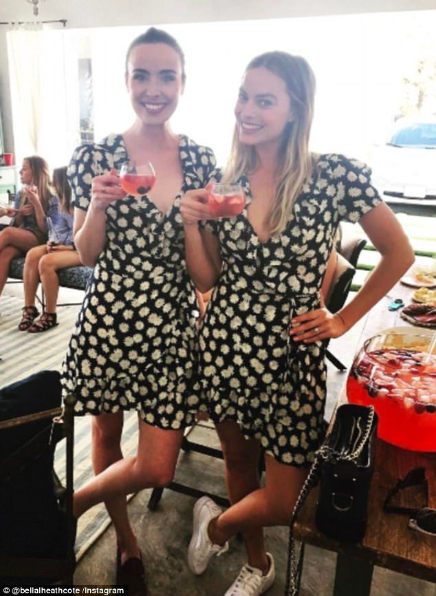 Twinning! Neighbours alumna Margot Robbie, 26, and Ashleigh Brewer, 26, haven't lost touch with each other dressing in the same dress at a recent Easter gathering