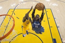 Minnesota Timberwolves forward Shabazz Muhammad (15) is fouled by Golden State Warriors forward Draymond Green (23) during the second half at Oracle Arena. The Timberwolves defeated the Warriors 124-117.  #9233396