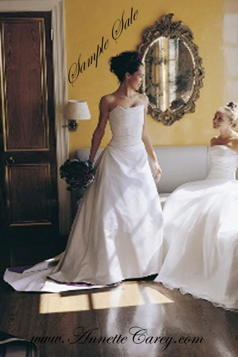 Bride standing. To make for you from £1,995.  Sample sale dresses available tried on in design salon, size 10 - 12 for £250 each.