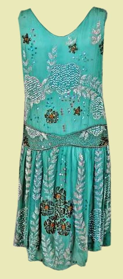 1920's Ethereal Turquoise Beaded Flapper Dress.  Silk-chiffon evening dance dress.  Glossy glass-beads are mixed in beautiful floral-motif patterns.  All that work is even more amazing when you realize the art-deco embroidered craftwork is done by hand. Back