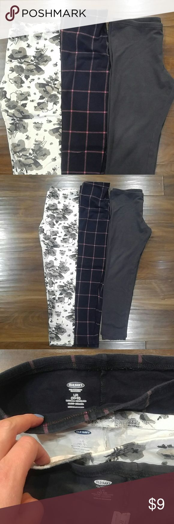 3 pair of Old Navy leggings Three pair of leggings from Old Navy. Size 10/12. In gently used condition. Navy with pink plaid, cream with grey and black floral and charcoal grey with lace ankle hem. Old Navy Bottoms Leggings