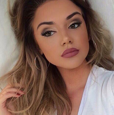 Beautiful natural makeup. Bold dark nude lip.