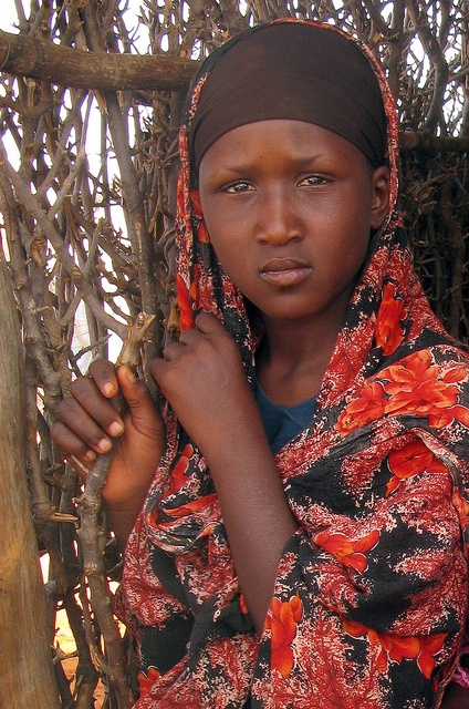A young woman waits to receive UK-funded food aid in Dolow, Somalia by DFID - UK Department for International Development, via Flickr: Dfid Photo