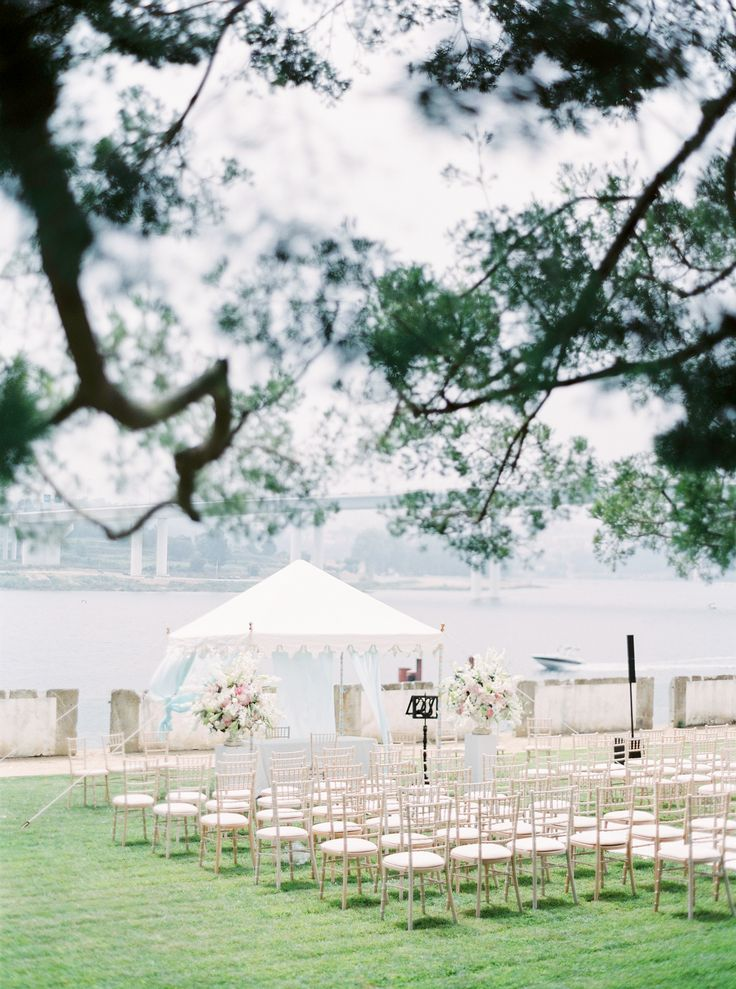 Outdoors wedding ceremony in Oporto. Tent from The Raj Tent Club. Decor by The Wedding Company - Portugal.   Photo by Branco Prata
