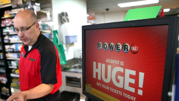 This is unbelievable. Jim Bayci sells a Powerball lottery ticket at his 7-Eleven store Nov. 28, 2012, in Chicago. - nope wasn't me.