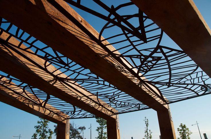 Landscape Design - Timber pergola with custom designed corten 'Falling Leaves' screens