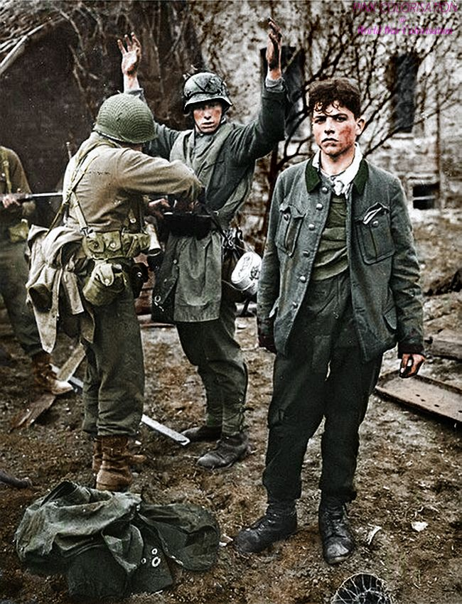 https://www.facebook.com/World-War-Colorisation-790508287736232/ Two German snipers surrender to GIs of the 3rd Army in Koblenz. The youngster on the right was wounded by US return fire, 26 March...