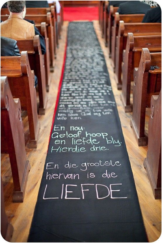 1 Corinthians 13, in Afrikaans on a long piece of black material with fabric paint. Could also use blackboard paint?