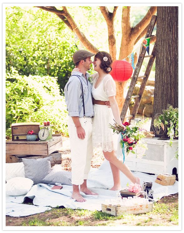 i love everything about this shoot. the beautiful picnic, the wild bouquet, his suspenders