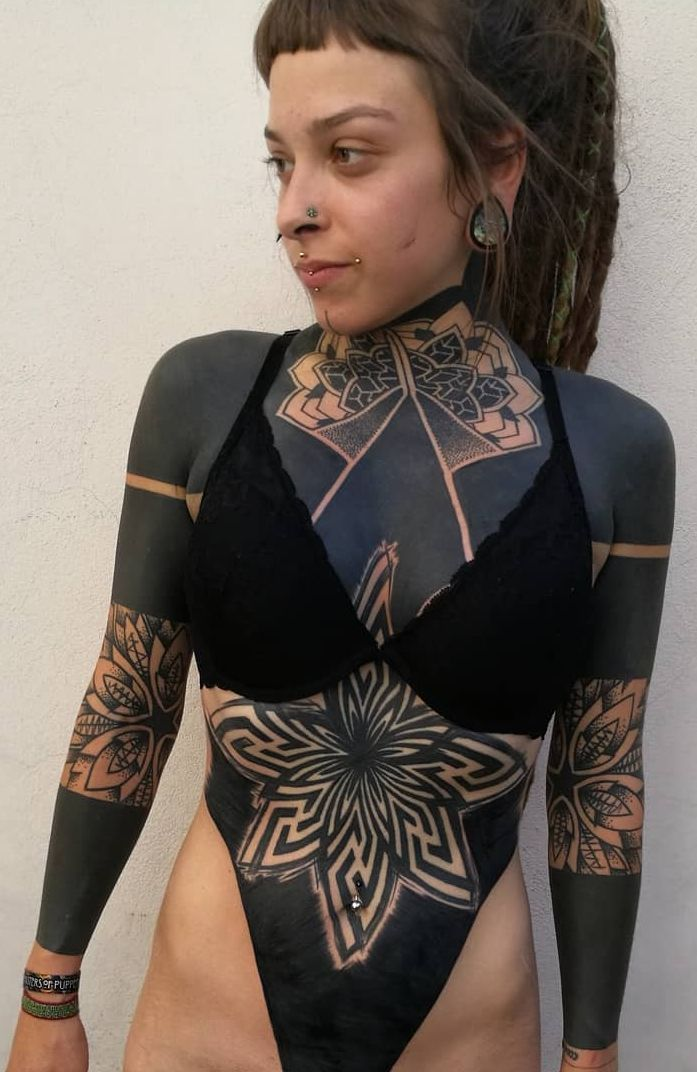 These Striking Solid Black Tattoos Will Make You Want To Go All In Blackout Tattoo Solid Black Tattoo Body Suit Tattoo