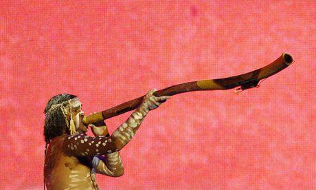 An Australian aborigine performs with a didgeridoo.