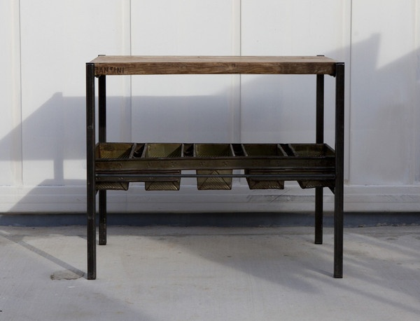 This terrific industrial table is a handmade masterpiece. The center of this table is a vintage industrial bread-cooling rack. A California artist welded steel legs and foot bars around the tray to form the base of the table. The wood top is made from thick upcycled scaffolding and is sealed from the elements. SHIPPING INCLUDED. Continental U.S. only. $650