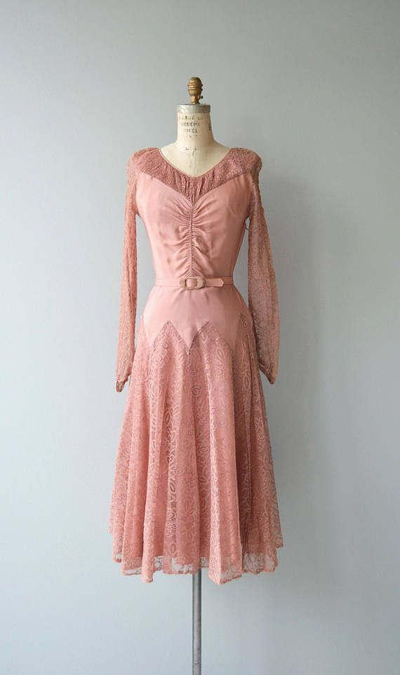 Vintage 1940s dusty rose rayon crepe dress with center ruched bodice, fitted waist and flared skirt with lace overlay. Lace sleeves and gathered neckline detail, comes with fabric belt, metal side zip closure. --- M E A S U R E M E N T S ---  fits like: extra small bust: 32-33 waist: 24 hip: 38 length: 47.5 brand/maker: n/a condition: excellent, one small water spot on the bust  to ensure a good fit, please read the sizing guide: http://www.etsy.com/shop/DearGold...