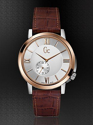 A slim style that exhibits a classical design with a modern twist, this timepiece is tailored for the self-confident individualist who looks for the out of the ordinary. Features a sleek 6.5mm stainless steel case and rose gold PVD bezel with a mini sweep movement at the 7 o'clock and a brown croco-embossed leather strap.                                              &