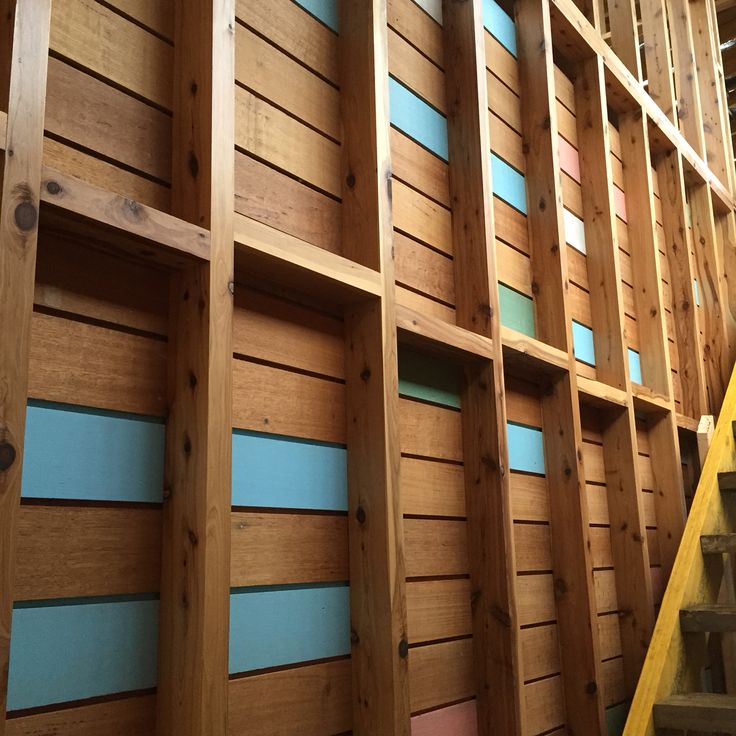 Recycled timber we used to create a feature wall in a stairwell, the coloured boards are to create a mcm feel.