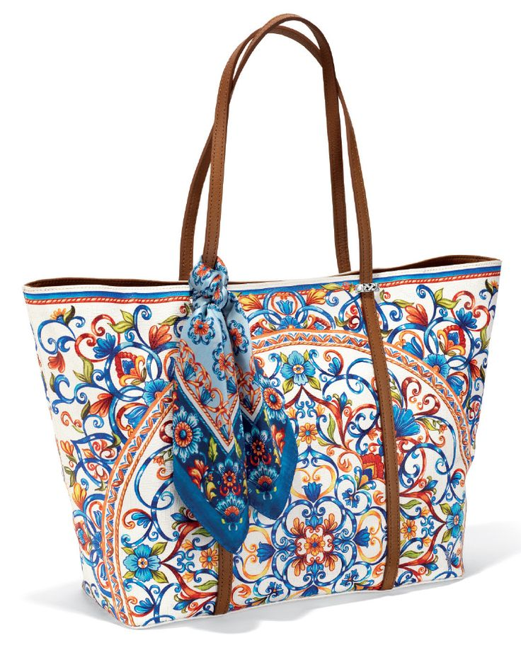 Brighton's Piatto Scarf Tote's luggage-hued luxe leather trim and stain resistant, coated canvas shopper is perfect for days spent traveling or wandering around the marketplace. The Piatto scarf is a bonus!