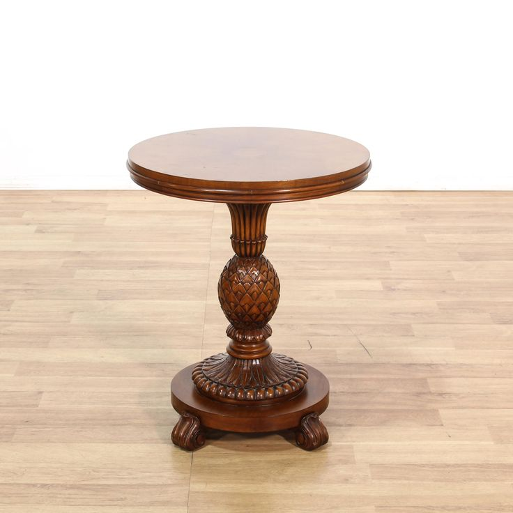 """This """"Ethan Allen"""" end table is featured in a solid wood with a mahogany stain. This coastal style side table has a carved pineapple pedestal base, round top, and intricate swirl details. Perfect for adding tropical vibes to your home! #coastal #tables #endtable #sandiegovintage #vintagefurniture"""