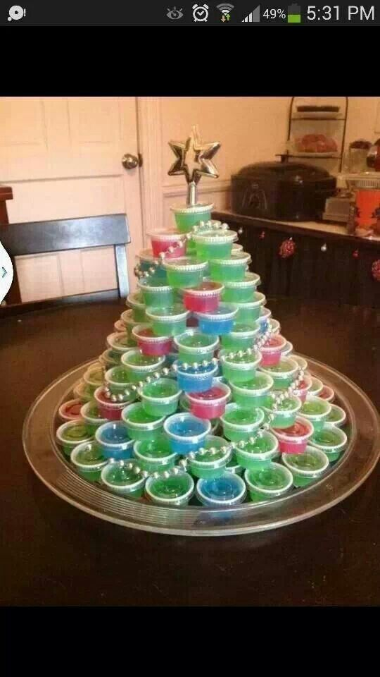 Jello shot christmas tree!! @Lindsey Grande Spillers I think you should do this for the christmas party.