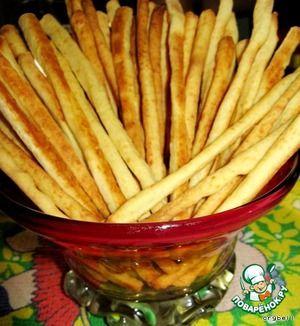 Сырная соломка за 25 минут Ингредиенты: Сыр твердый (около 150 грамм) — 1 стак. Мука пшеничная — 1,5 стак. Масло сливочное — 80 г Молоко — 4 ст. л. Соль (по вкусу) Лимонная цедра (от одного маленького лимона) тмин, кунжут (необязательно, но можете добавить по желанию)