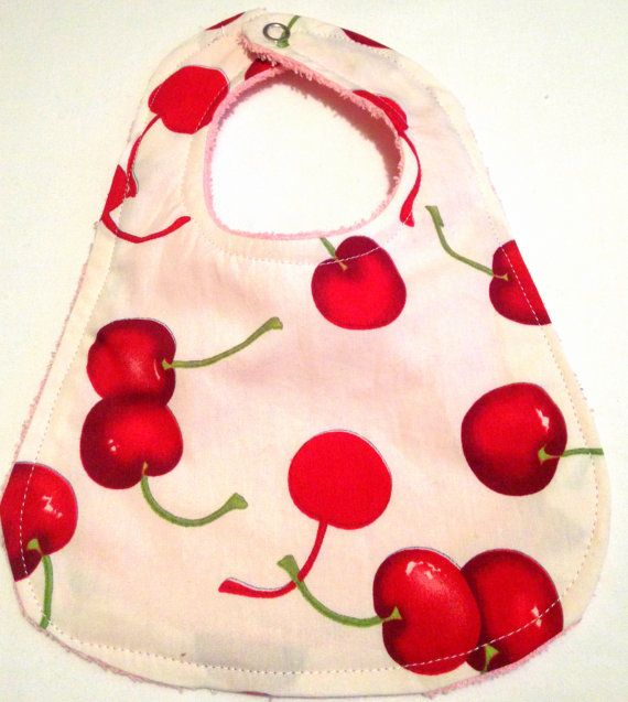 Welcome to LJs Dub Shack  Your little one will look adorable in this very cool handmade cherry bib.  Using bright colours and retro designs, we make