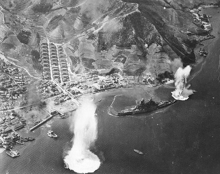 Carrier aircraft of US 3rd Fleet planes attacking battleship Haruna, Kure, Japan 28 Jul 1945; photo taken by aircraft from USS Intrepid.