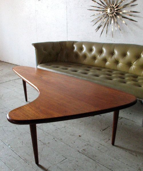 Boomerang coffee table and olice green couch. Mid Century Modern furniture - mad men
