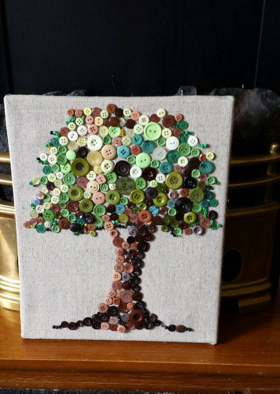 Detailed button tree, recovered canvas, home decor Inspiration This tree represents the tree from the garden of Eden bearing fruit which gave eternal life. A very powerful symbolic picture. Here is my interpretation with a spring/summer and autumn tree. Beautiful mixed media canvas Design This beautiful canvas has been recovered with natural stone linen. I have then completed the intricate design with numerous shades and sized buttons. I have also added numerous beads to make the detail ...