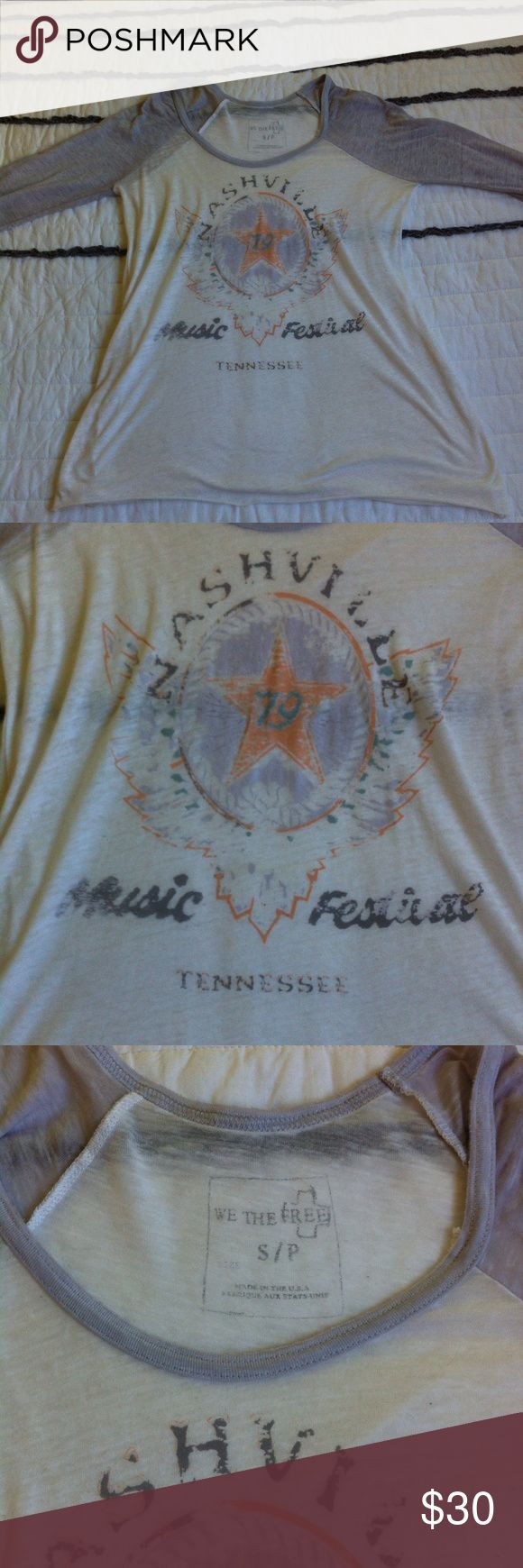 Free People Nashville tee Free People Nashville music festival tee. Light and soft burnout fabric. Excellent condition. Hems are intentional raw and distressed Free People Tops