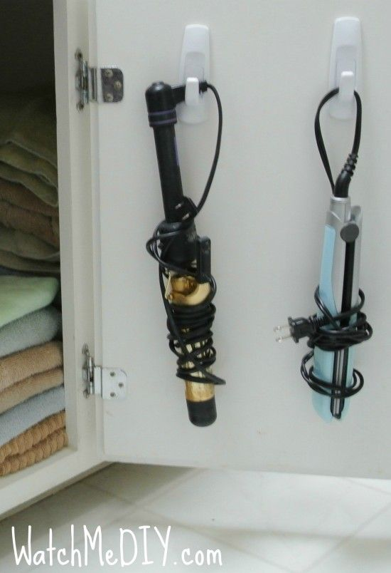 bathroom organization - DIY - hang your hairdryer + curling iron to save space. perfect storage solution