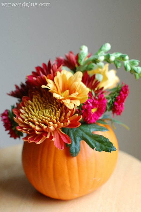 DIY: Hollow out pie pumpkin, put water and floral foam inside pumpkin. Push stems of flowers into floral foam. Easy peasy.