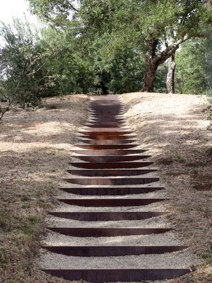 Corten stairs set into the earth - quiet yet strong. Andrea Cochran
