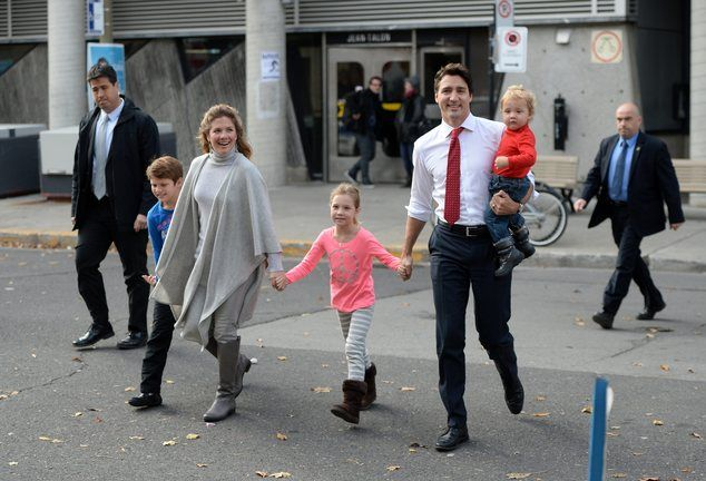 Liberal leader Justin Trudeau, second right, and family arrive to vote at a polling statio...