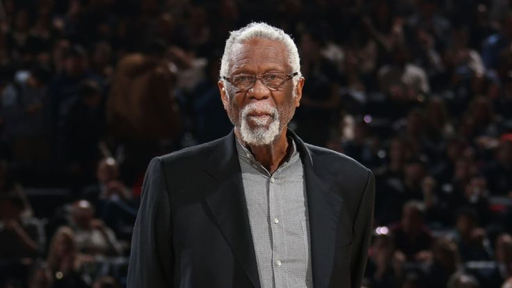 Bill Russell, in a kneeling pose that surfaced online, donned his Presidential Medal of Freedom in an apparent show of solidarity over President Donald Trump's comments about protesting NFL players.