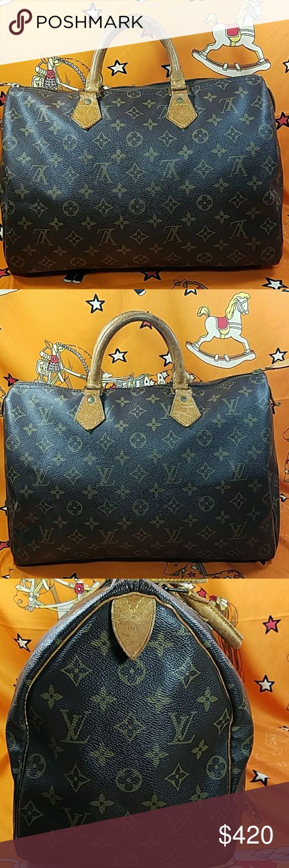 "Authentic Louis Vuitton Monogram Speedy 35 The outer leather is in good condition. The leather trims and handles  (drop about 5"") showed sign of used with scratches, stains & darkened. The zipper pull tag is replaced. Inside bag has some stains on the bottom. Date code SP1912. It made in France. Dimension:(about) 10.5, 14, & 8. No trade please Louis Vuitton Bags Satchels"