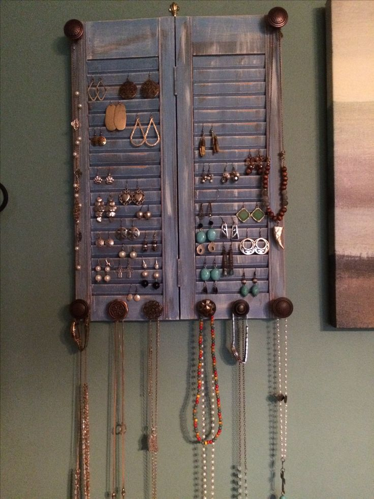 Old shutter, distressed & repurposed as a jewelry organizer.