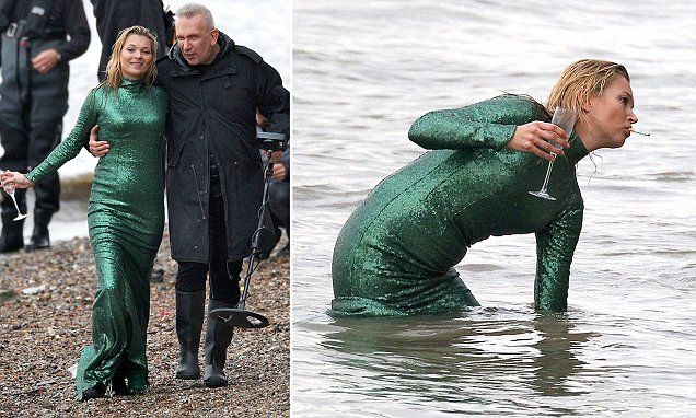 Kate Moss emerges from the Thames with a cigarette in her mouth as she films Ab Fab movie