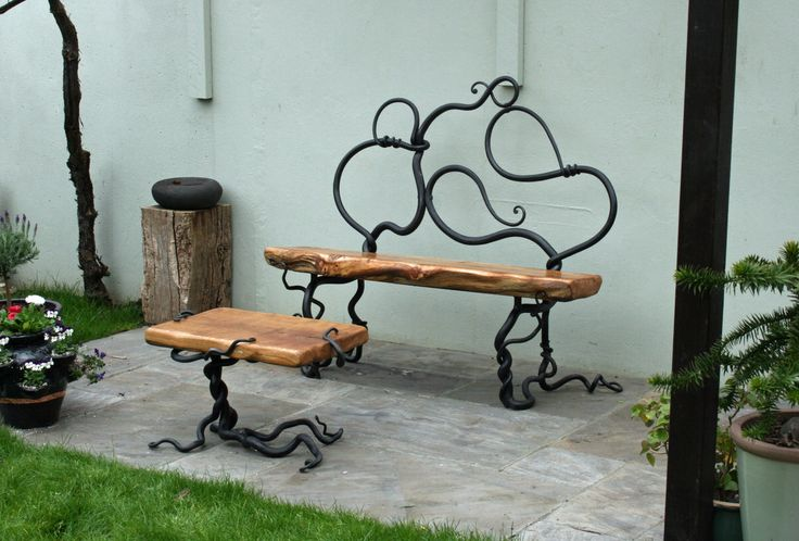 Rustic bench and table bespoke garden furniture commission forged steel and oak by sculptor Mark Reed