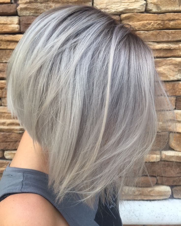 Silver grey hair in a concave bob
