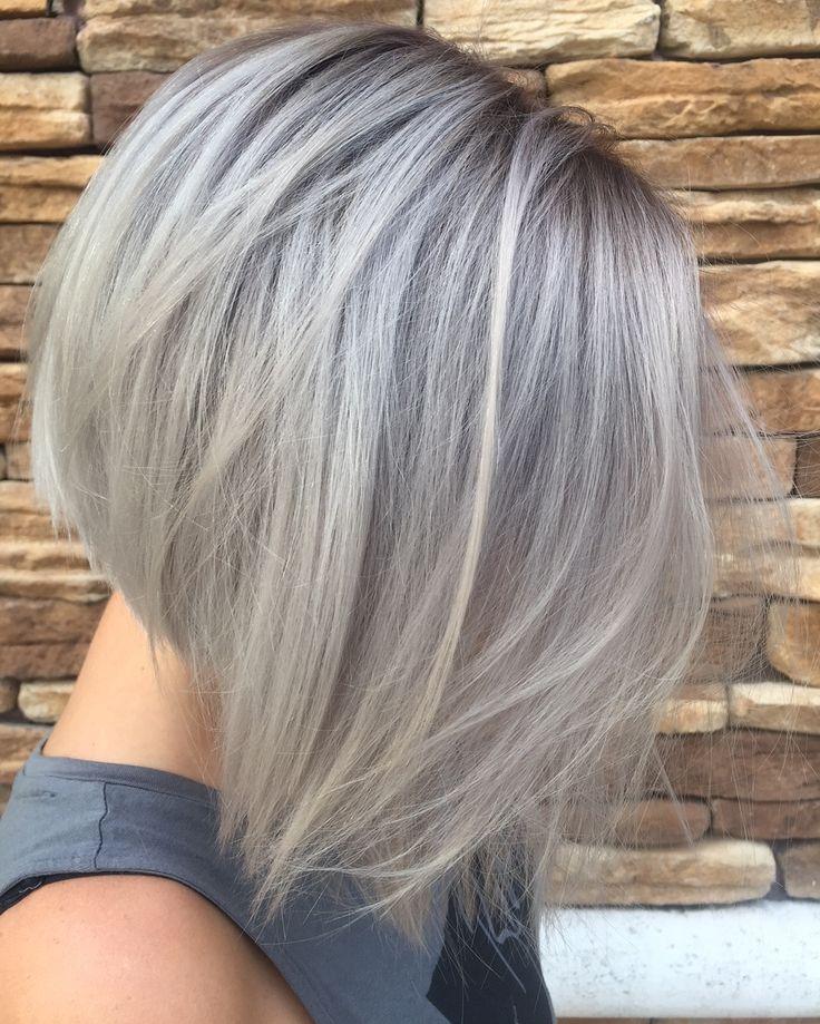 Silver grey hair in a concave bob