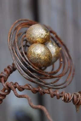 barbed wire nest? Or use old bed springs.