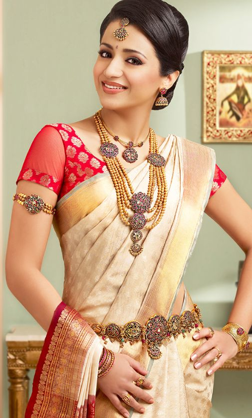 Trsha in half white Pattu Saree and Jewellery